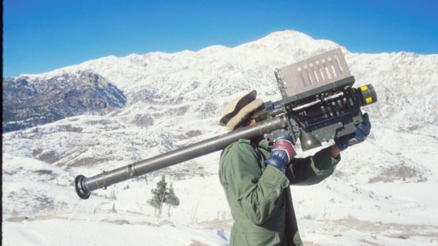 Afghan guerrilla with missile launch site