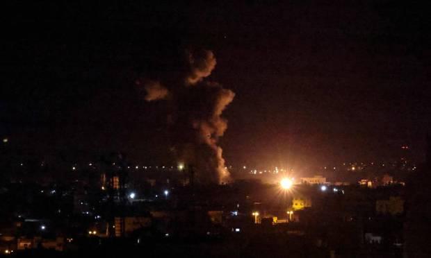 Smoke and fireballs rise after an air strike on Rafah in the southern Gaza Strip Photo: Saeed Al-Khatib/AFP
