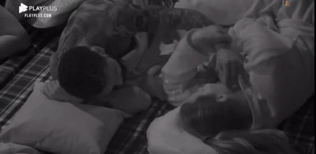 Nego do Borel tries to pet Diane Milo's face