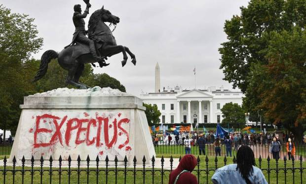 Statue of US President Andrew Jackson in Lafayette Square, Washington, painted with the words & #034;  Wait for us & # 034;  While protesting environmental and indigenous rights activists outside the White House.  Photo: MANDEL NGAN / AFP