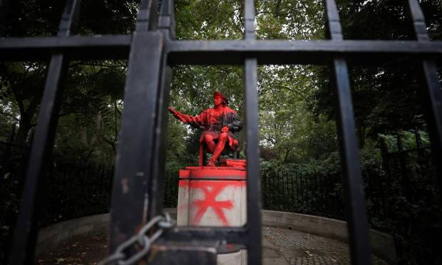 Vandalism of the statue of Christopher Columbus in London Photo: Hannah McKay/Reuters